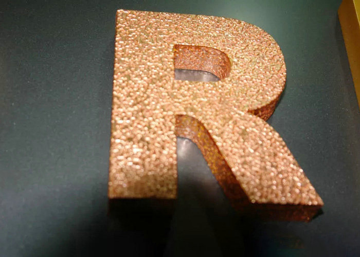 Metallic painting the letter with gold foil finish