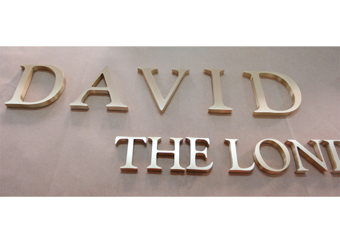 Welded light box brass letter logo